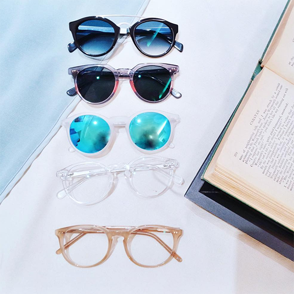 A collection of sunglasses and glass from Eyebuydirect on Instagram
