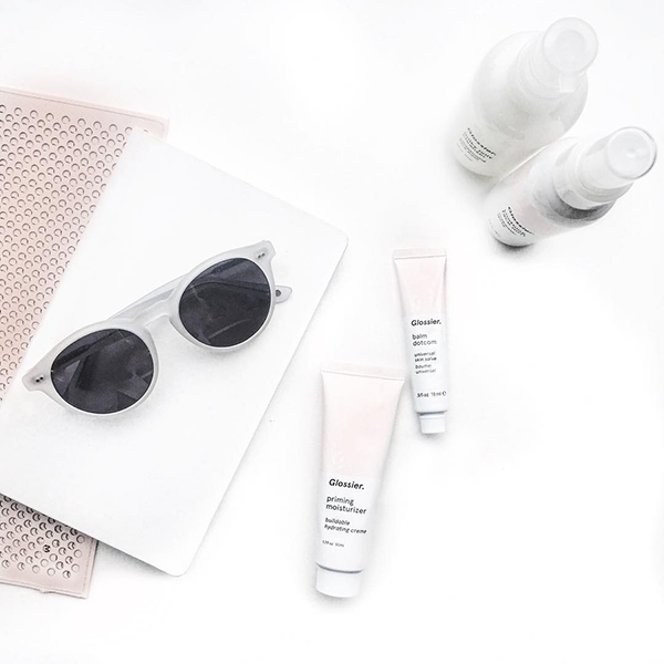 Luminance sunglasses on a table with some makeup on Instagram