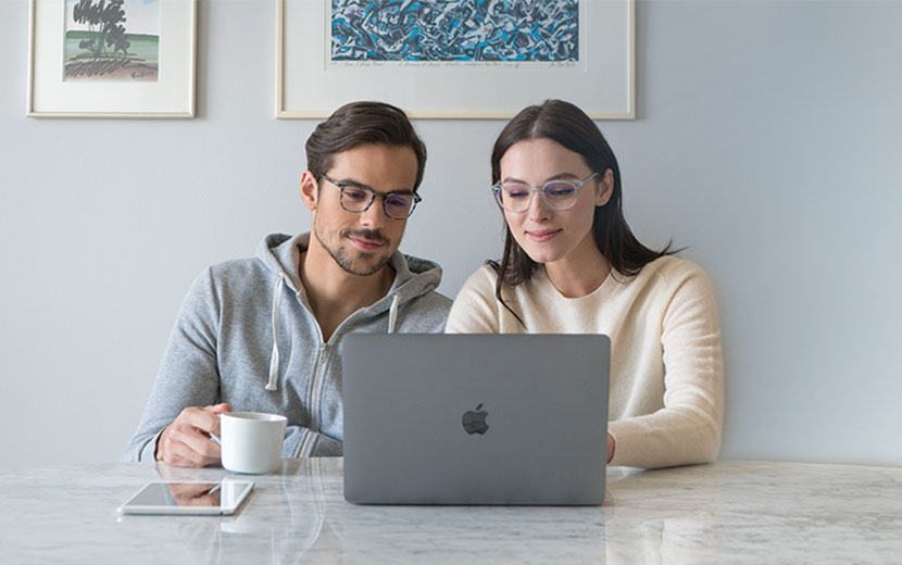 EyeBuyDirect Eyezen Glasses Couple with Laptop