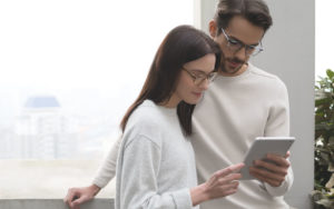 EyeBuyDirect Eyezen Glasses Couple with Tablet