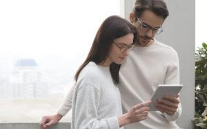 EyeBuyDirect Eyezen Glasses Couple with Tablet