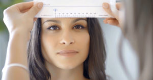 Woman measuring her pupillary distance
