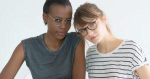 2 girls wearing eyeglasses