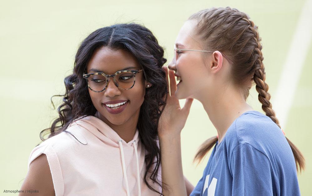 Two girls wearing eyeglasses