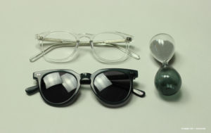 flat-lay-black-glasses-clear-glasses-hourglass
