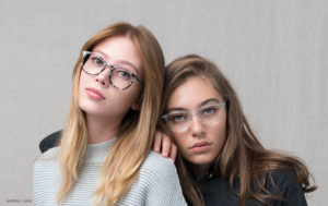 two girls glasses looking at camera
