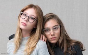 two-girls-glasses-looking-at-camera