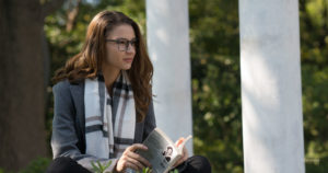 Woman reading outside in eyeglasses