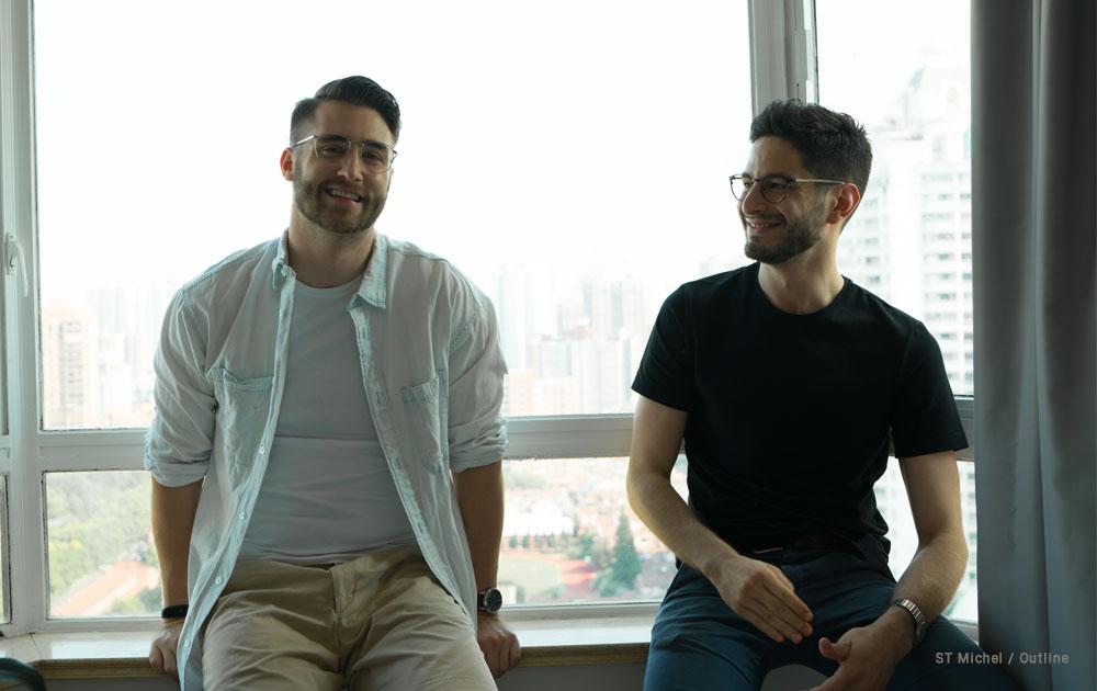 Two men wearing eyeglasses