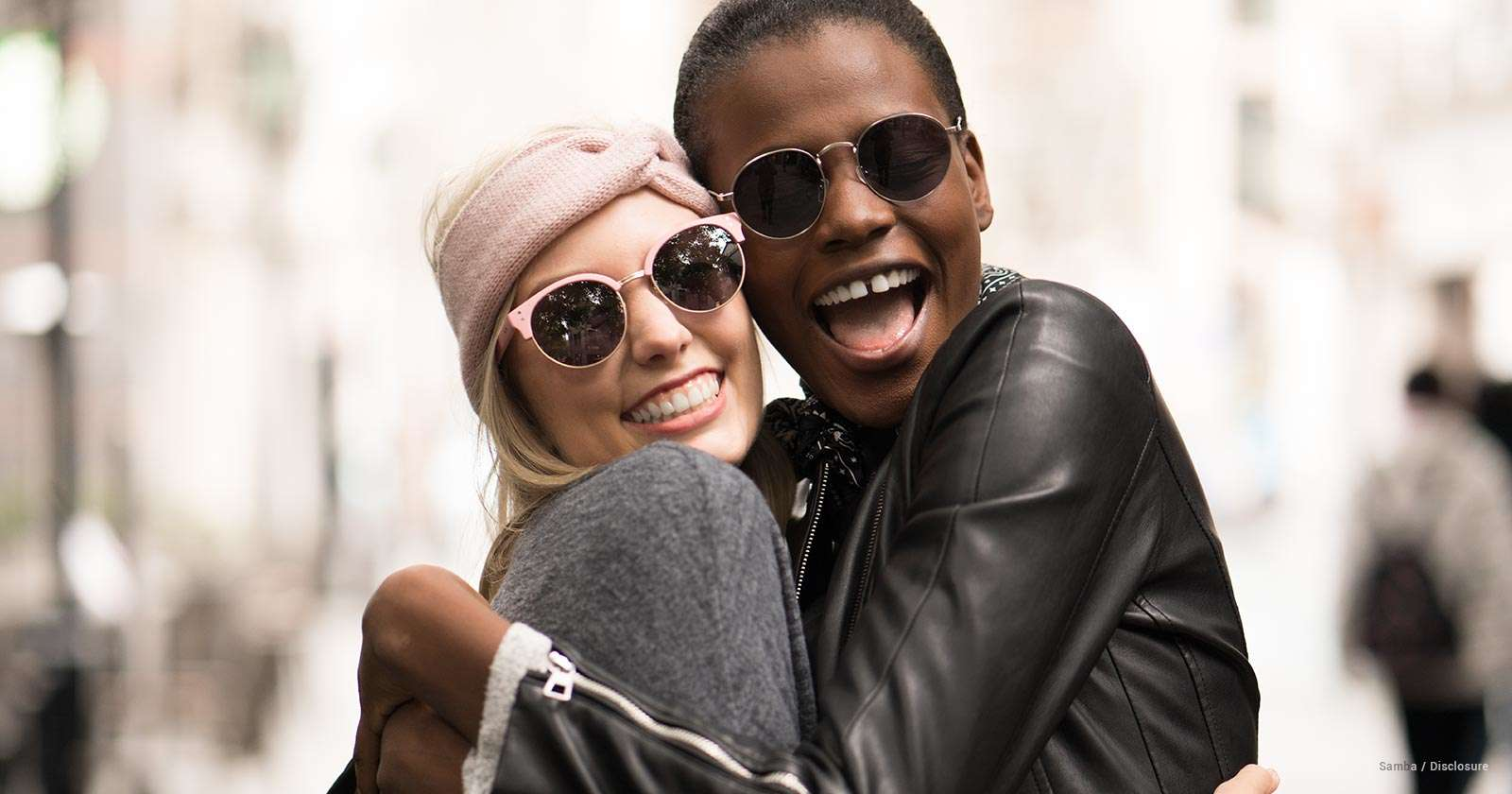 two girls - sunglasses - hug - styles of sunglasses