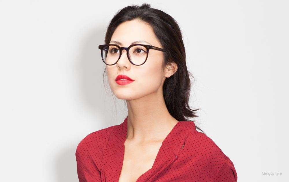 black horn rimmed glasses - woman - red shirt