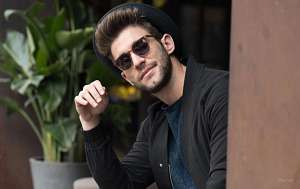 Man wearing wayfarer style sunglasses