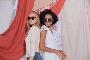Two girls wearing polarized sunglasses