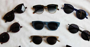 A selection of polarized sunglasses on a white sheet