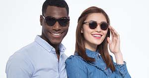 A couple wearing wayfarer style sunglasses