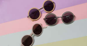 Round sunglasses on a pastel background