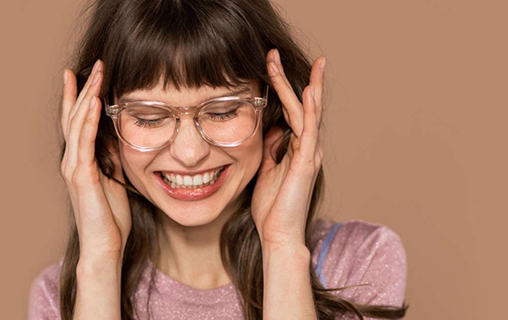 Smiling woman wearing progressive transition eyeglasses
