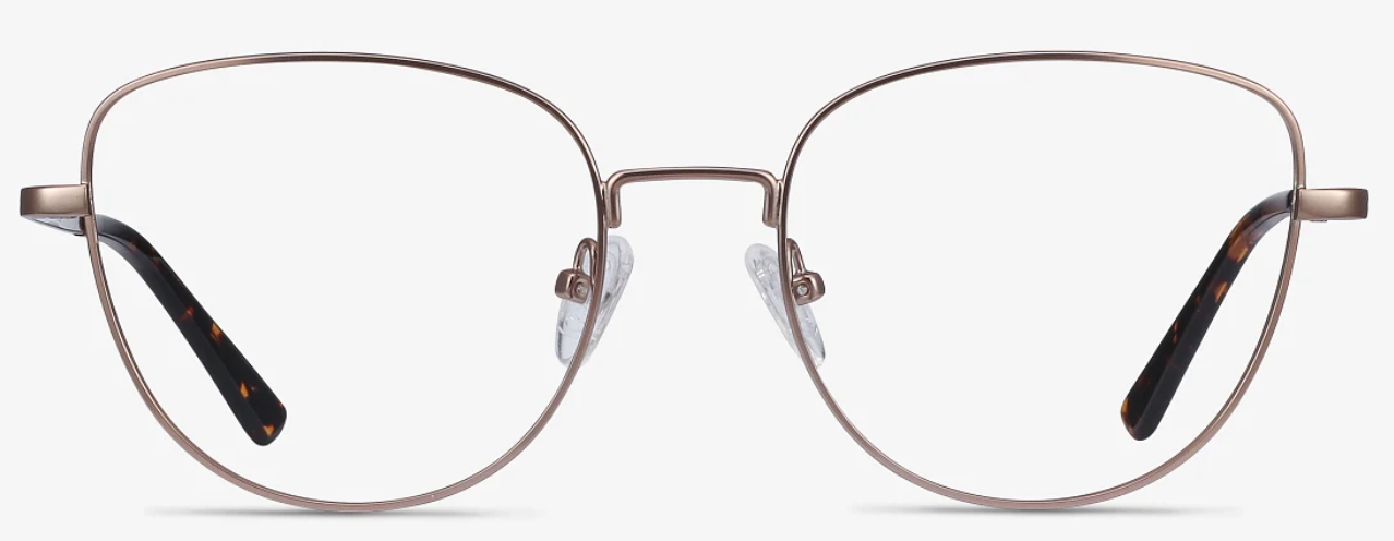 A pair of large rose gold colored eyeglasses