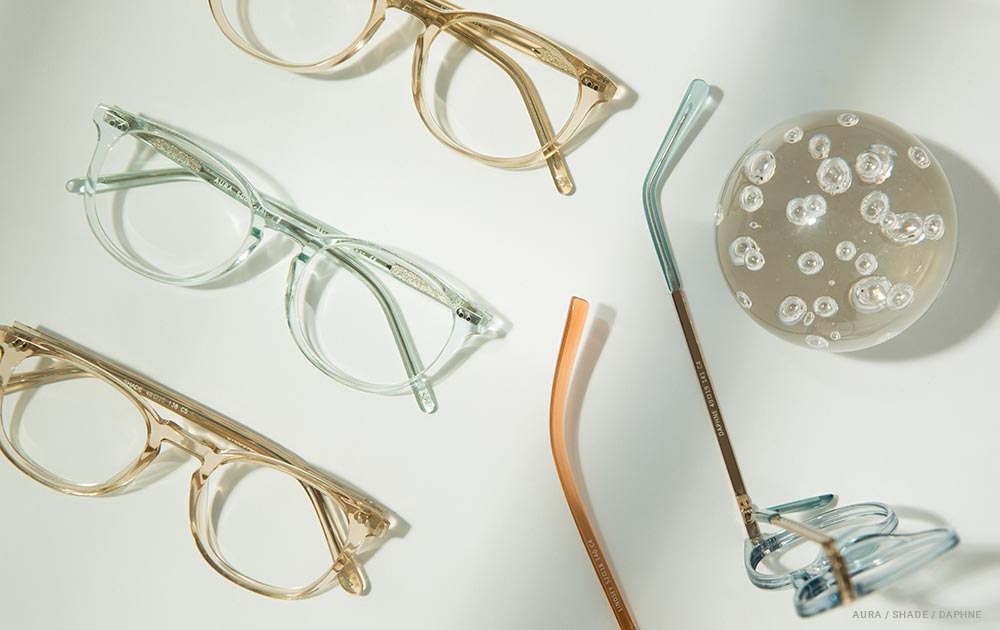 A selection of clear eyeglass frames on a white table
