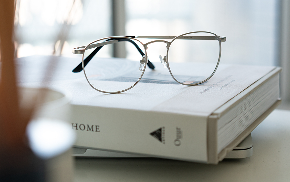 A pair of round eyeglasses on a book